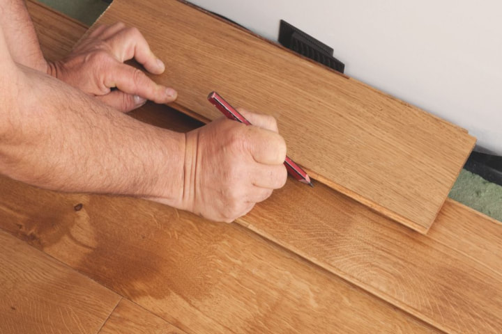 man measuring flooring and link gto flooring page