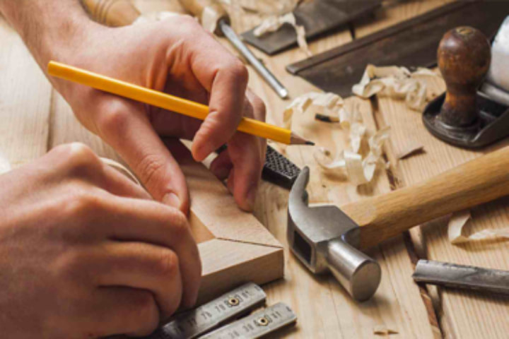 man preparing for carpentry work